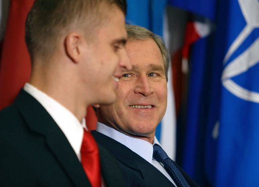 "President George W. Bush looks toward Gedrimas ""Jimmy"" Jaglinskas before being introduced by the West Point Cadet at a speech to the Prague Atlantic Student Summit in Prague, Czech Republic, Wednesday, Nov. 20. White House photo by Paul Morse."