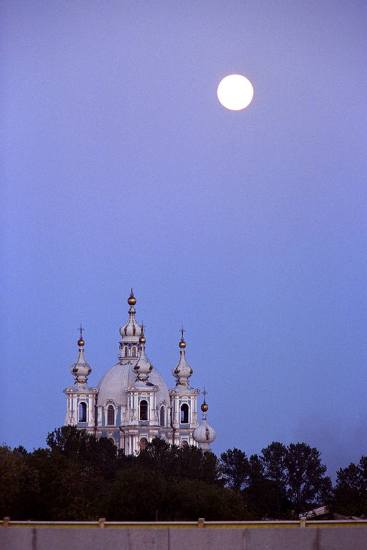 The moon rises at sunset in St. Petersburg, Russia. White House photo by Paul Morse