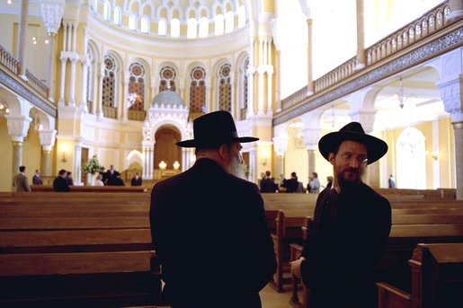 Leaders of the Jewish Community in St. Petersburg, Russia, stand inside the Grand Choral Synagogue while President Bush and Laura Bush tour restoration of the synagogue, the only Jewish house of worship in a city of 4.5 million people. White House photo by Paul Morse