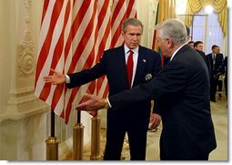 President George W. Bush and Lithuanian President Valdas Adamkus enter a bilateral meeting after President Bush received the Order of Vytautas the Great at the Prezidentura in Vilnius, Lithuania, Nov. 23. The medal is given to individuals whose contributions have benefited the Lithuanian nation or the welfare of mankind. White House Photo by Paul Morse.