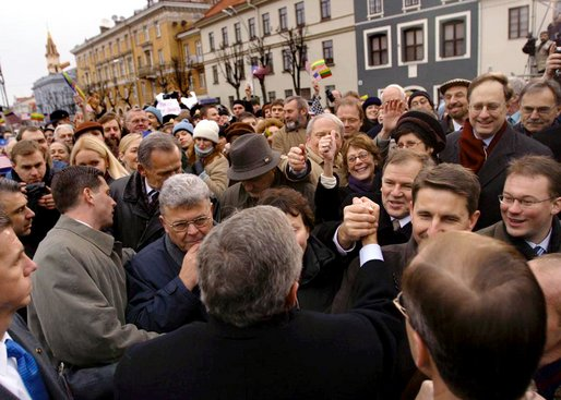 "President George W. Bush greets Lithuanians in person at the Rotuse Square in the center of Vilnius, Lithuania, Nov. 23. ""This is a great day in the history of Lithuania, in the history of the Baltics, in the history of NATO, and in the history of freedom,"" said President Bush in his remarks. ""And I have the honor of sharing this message with you: We proudly invite Lithuania to join us in NATO, the great Atlantic Alliance."" White House photo by Paul Morse"