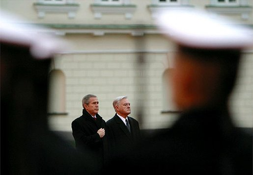 President George W. Bush and Lithuanian President Valdas Adamkus stand at attention during a welcoming ceremony at the Prezidentura, the Presidential Palace, in Vilnius, Lithuania, Nov. 23. A former Chicago-area resident and U.S. environmental regulator, President Adamkus was elected to office in 1998. White House photo by Paul Morse.