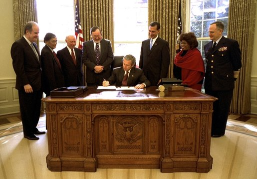 President George W. Bush signs the Maritime Transportation Security Act of 2002 in the Oval Office, Nov. 25, 2002. White House photo by Paul Morse.