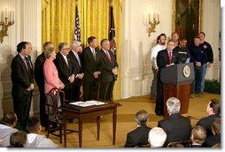 "President George W. Bush speaks during the signing of the Terrorism Risk Insurance Act in the East Room, Tuesday, Nov. 26. ""The Terrorism Risk Insurance Act will provide coverage for catastrophic losses from potential terrorist attacks. Should terrorists strike America again, we have a system in place to address financial losses and get our economy back on its feet as quickly as possible,"" said the President.  White House photo by Paul Morse"