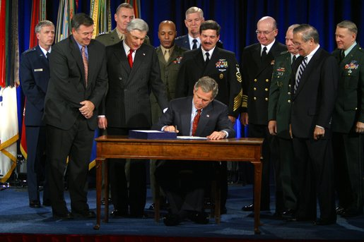 "President George W. Bush signs the Bob Stump National Defense Authorization Act at the Pentagon Monday, Dec 2. ""The legislation I sign this afternoon was passed by Congress in a remarkable spirit of unity. It sets priorities of our Defense Department in a critical, critical period for our country,"" said President Bush.""We're rewarding the service and sacrifice of our military families with higher pay, improved facilities and better housing."" White House photo by Paul Morse"