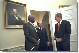 "President George W. Bush welcomes President Daniel arap Moi of Kenya, left, and Prime Minister Meles Zenawi of Ethiopia to the Oval Office Dec. 5. ""We welcome two strong friends of America here; two leaders of countries which have joined us in the -- to fight the global war on terror; two steadfast allies, two people that the American people can count on when it comes to winning the first war of the 21st century,"" said President Bush during their meeting in the Cabinet Room.  White House photo by Eric Draper"