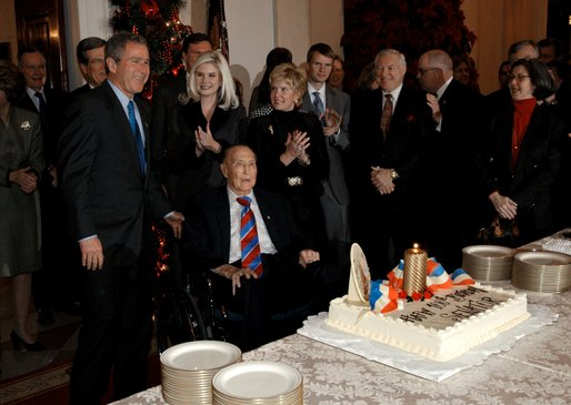 President George W. Bush wishes Sen. Strom Thurmond happy birthday during a birthday celebration at the White House Dec. 6, 2002. The South Carolina senator turned 100 years old Thursday. White House photo by Eric Draper.