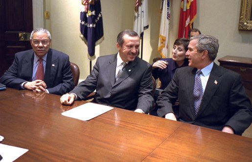 "President George W. Bush meets with Recep Tayyip Erdogan, Chairman of Turkey's AK Party during National Security Advisor Dr. Condoleezza Rice's meeting in the Roosevelt Room, Tuesday, Dec. 10, 2002. Also pictured is Secretary of State Colin Powell. ""We join you, side by side, in your desire to become a member of the European Union. We appreciate your friendship in NATO. You're a strategic ally and friend of the United States, and we look forward to working with you to keep the peace, "" said President Bush during the brief meeting. White House photo by Paul Morse"