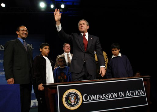 President George W. Bush waves to the audience after signing an executive order for equal protection of the laws for faith-based and community organizations in Philadelphia, Pa., Thursday, Dec. 12. White House photo by Eric Draper
