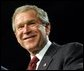 President George W. Bush smiles during his remarks at the White House Regional Conference on Faith-Based Initiatives in Philadelphia, Pa., Thursday, Dec. 12. White House photo by Eric Draper