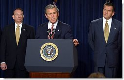President George W. Bush discusses his smallpox vaccination program during a press conference as Secretary of Health & Human Services Tommy Thompson, left, and Director of the Office of Homeland Security Tom Ridge in the Dwight D. Eisenhower Executive Office Building Friday, Dec. 13.   White House photo by Paul Morse