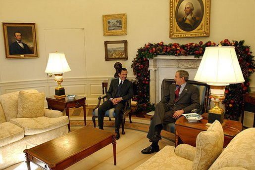 President George W. Bush meets with Sultan Hassanal Bolkiah of Brunei in the Oval Office Monday, Dec. 16. White House photo by Tina Hager.