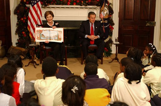 "President George W. Bush and Laura Bush read ""'Twas the Night Before Christmas,"" to a class of third-graders during the White House Story Hour in the Roosevelt Room Tuesday, Dec. 17. White House photo by Tina Hager."