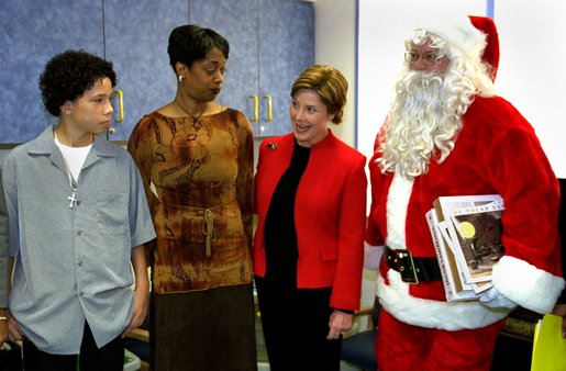 Laura Bush meets with Iran Brown, left , the 13-year-old victim of the Washington-area sniper, and his mother, Lisa Brown, after visiting with children in the neurology and orthopedic units at the Children's National Medical Center in Washington, D.C. Thursday, December 12, 2002. Mrs. Bush invited Brown to co-host the annual children's Christmas program. White House photo by Susan Sterner.