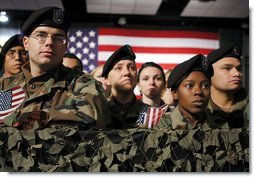 "Army troops and personnel listen to President George W. Bush during his visit to Fort Hood in Killeen, Texas, Friday, Jan. 3, 2003. ""Ft. Hood and the units that call it home have a special place in our country's military history, said the President. ""For decades, soldiers from the First Team and the Iron Horse Division, and from other units, have fought America's battles with distinction and courage.""  White House photo by Eric Draper"