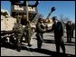 President George W. Bush greets army soldiers in front of tank equipment during a visit to Fort Hood in Killeen, Texas, Friday, Jan. 3, 2003. White House photo by Eric Draper.