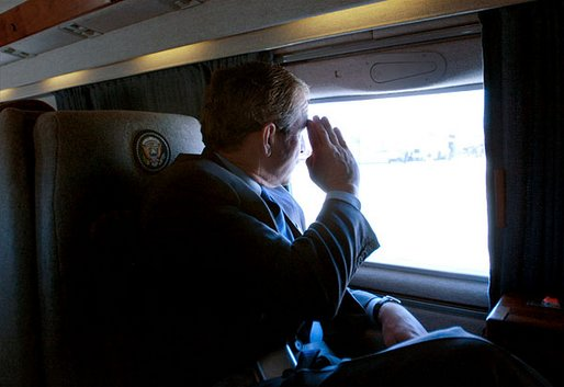 President George W. Bush salutes as he departs Fort Hood after addressing and meeting one-on-one with army troops in Killeen, Texas, Friday, Jan. 3, 2003. White House photo by Eric Draper.