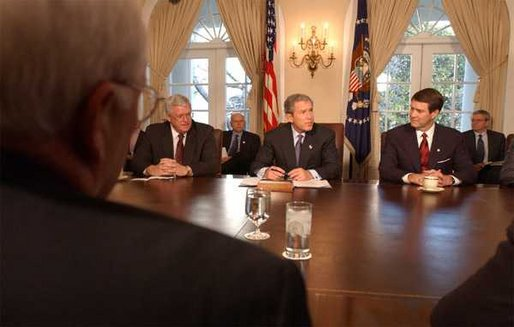 President George W. Bush signs the Temporary Extended Unemployment Compensation Act of 2002 in the Cabinet Room, Tuesday, Jan 7, 2003. Seated with the President are Sen. Bill Frist, right, Senate Majority Leader, and Congressman Dennis Hastert, left, Speaker of the House. The bill extends a federal program to provide 13 weeks of benefits for the unemployed who have exhausted their 26 weeks of state unemployment. White House photo by Tina Hager