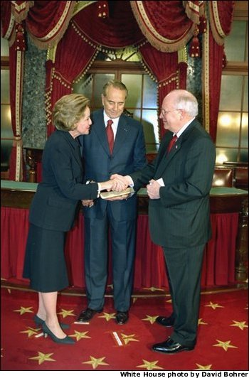 In his role as President of the Senate, Vice President Dick Cheney presides over the swearing in of 35 new senators as part of the opening of the 108th Congress Tuesday Jan. 7, 2003. Here, the Vice President congratulates newly-elected Senator Elizabeth Dole, R-N.C., in the Old Senate Chamber of the Capitol as her husband, former Senator Bob Dole, looks on. White House photo by David Bohrer