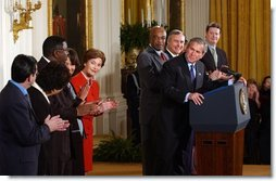 President George W. Bush acknowledges school principals and superintendents, education leaders, and Members of Congress in celebrating the one-year anniversary of the signing of the No Child Left Behind Act in the East Room, Wednesday, Jan. 8, 2003.  White House photo by Tina Hager