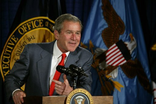 "President George W. Bush talks with the employees of National Capital Flag Company in Alexandria. Va., about his Growth and Jobs Package, Thursday, Jan. 9, 2003. ""This is a plan to encourage growth, focusing on jobs. And the Council of Economic Advisors has predicted that these proposals will create 2.1 million new jobs over the next three years. That's good for the American people. It's good for our economy, "" President Bush said after his tour of the company. White House photo by Paul Morse"