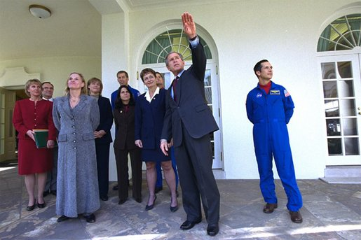President George W. Bush gives a tour of the Rose Garden to crew members of Space Shuttle Endeavour Mission STS-113 and Expeditions 1,4,and 5 Wednesday, Jan. 15, 2003. The next orbiter launch will be Thursday, Jan. 16, carrying the crew of the Space Shuttle Columbia Mission STS-107 to the International Space Station. White House photo by Tina Hager.