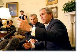 President George W. Bush and Polish President Aleksander Kwasniewski meet with the media in the Oval Office Jan. 14, 2003.  White House photo by Paul Morse