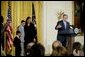 "President George W. Bush addresses the audience during a program honoring graduates of welfare-to-work programs in the East Room Tuesday, Jan. 14, 2003. ""In the seven years since welfare was reformed, millions of Americans have shared in this experience. Their lives and our country are better off. Today, more than 2 million fewer families are on welfare -- 2 million fewer than in 1996. It's a reduction of 54 percent,"" said the President. White House photo by Paul Morse."
