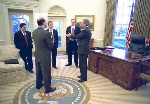Shortly before delivering his remarks to the media, President George W. Bush discusses his decision regarding the University of Michigan Admission policies with, from left to right, Counsel Alberto Gonzales, Press Secretary Ari Fleischer, Assistant Jay Lefkowitz and Communications Director Dan Bartlett in the Oval Office Wednesday, Jan. 15, 2003. White House photo by Paul Morse