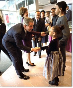 Greeting 6-year-old Natalie Jenkins, President George W. Bush and Laura Bush meet Pastor John K. Jenkins, Sr.'s family at the First Baptist Church of Glenarden in Landover, Md., Monday, Jan. 20, 2003. The church holds an annual service celebrating the legacy and life of Dr. Martin Luther King, Jr.  White House photo by Eric Draper