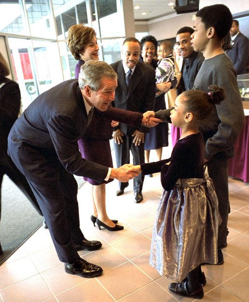 Greeting 6-year-old Natalie Jenkins, President George W. Bush and Laura Bush meet Pastor John K. Jenkins, Sr.'s family at the First Baptist Church of Glenarden in Landover, Md., Monday, Jan. 20, 2003. The church holds an annual service celebrating the legacy and life of Dr. Martin Luther King, Jr. White House photo by Eric Draper.