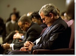 "President George W. Bush prays during a church service honoring Dr. Martin Luther King, Jr. at the First Baptist Church of Glenarden in Landover, Md., Jan. 20, 2003. ""It is fitting that we honor this great American in a church because, out of the church comes the notion of equality and justice,"" said the President in his remarks.  White House photo by Eric Draper"