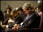 "President George W. Bush prays during a church service honoring Dr. Martin Luther King, Jr. at the First Baptist Church of Glenarden in Landover, Md., Jan. 20, 2003. ""It is fitting that we honor this great American in a church because, out of the church comes the notion of equality and justice,"" said the President in his remarks. White House photo by Eric Draper."