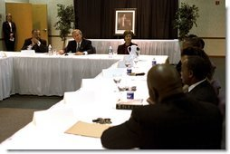 "Celebrating the national observance of Dr. Martin Luther King, Jr.'s birthday, President George W. Bush, Laura Bush and Pastor John K. Jenkins, Sr., far left, take part in a roundtable discussion with congregation members and community leaders at the First Baptist Church of Glenarden in Landover, Md., Jan. 20, 2003. ""It is fitting we meet here in a church because in this society, we must understand government can help, government can write checks -- but it cannot put hope in people's hearts or a sense of purpose in people's lives,"" said the President in his remarks.  White House photo by Susan Sterner"