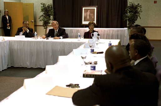 "Celebrating the national observance of Dr. Martin Luther King, Jr.'s birthday, President George W. Bush, Laura Bush and Pastor John K. Jenkins, Sr., far left, take part in a roundtable discussion with congregation members and community leaders at the First Baptist Church of Glenarden in Landover, Md., Jan. 20, 2003. ""It is fitting we meet here in a church because in this society, we must understand government can help, government can write checks -- but it cannot put hope in people's hearts or a sense of purpose in people's lives,"" said the President in his remarks. White House photo by Susan Sterner."
