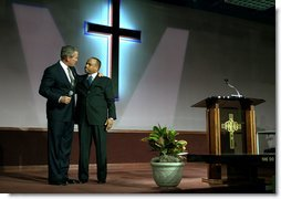 "President George W. Bush embraces Pastor John K. Jenkins, Sr. of the First Baptist Church of Glenarden during an annual service honoring Dr. Martin Luther King, Jr. in Landover, Md., Monday, Jan. 20, 2003. ""And even though progress has been made, Pastor -- even though progress has been made, there is more to do,"" said the President in his remarks. ""There are still people in our society who hurt. There is still prejudice holding people back. There is still a school system that doesn't elevate every child so they can learn.""  White House photo by Susan Sterner"