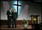 "President George W. Bush embraces Pastor John K. Jenkins, Sr. of the First Baptist Church of Glenarden during an annual service honoring Dr. Martin Luther King, Jr. in Landover, Md., Monday, Jan. 20, 2003. ""And even though progress has been made, Pastor -- even though progress has been made, there is more to do,"" said the President in his remarks. ""There are still people in our society who hurt. There is still prejudice holding people back. There is still a school system that doesn't elevate every child so they can learn."" White House photo by Susan Sterner."