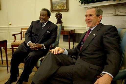 President George W. Bush and President Ismail Omar Guelleh of Djibouti greet the press during a meeting in the Oval Office Jan. 21, 2003. White House photo by Paul Morse