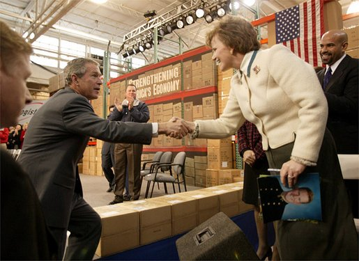 "President George W. Bush greets employees at JS Logistics in St. Louis, Mo., after discussing his economic stimulus package Wednesday, Jan. 22, 2003. ""It's important for our fellow Americans to understand that the strength of our country, the strength of our economy really depends upon the strength of the small business community all across America. And that's why I'm here today in this small business, to remind people about the importance of small business,"" President Bush said. White House photo by Paul Morse"