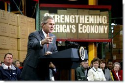 President George W. Bush talks with owners and employees of JS Logistics in St. Louis, Mo., about his economic stimulus package Wednesday, Jan. 22, 2003.  White House photo by Paul Morse