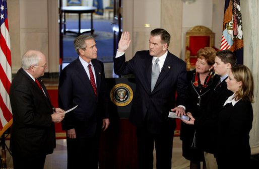 "As President George W. Bush watches, Vice President Dick Cheney swears in Tom Ridge as the Secretary of the Department of Homeland Security in the Cross Hall Jan. 24, 2003. Secretary Ridge's wife, Michele, and children, Tom and Lesley, hold the Bible during the administering of the oath. ""In October of 2001, when I established the office -- the White House Office of Homeland Security -- I knew immediately that Tom was the right man for the assignment. He's a decisive, clear-thinking executive who knows how to solve problems. He's a person of integrity and a person of good judgment,"" said the President in his remarks. White House photo by Paul Morse"