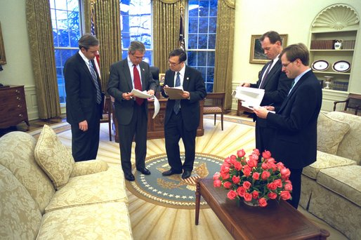 President George W. Bush prepares his State of the Union speech with Dan Bartlett, White House Communications Director, at left,  Mike Gerson, director of Presidential Speechwriting, and speech writers Matthew Scully and John McConnell in the Oval Office Thursday, January 23, 2003. White House photo by Eric Draper