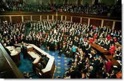 "Congress applauds President Bush during his State of the Union Address at the U.S. Capitol Tuesday Jan. 28, 2003. Discussing the spread of the AIDS virus, President Bush asked Congress to commit $15 billion in aid for African nations and the Caribbean tormented by the disease. ""The qualities of courage and compassion that we strive for in America also determine our conduct abroad,"" said the President. ""This conviction leads us into the world to help the afflicted, and defend the peace, and confound the designs of evil men.""   White House photo by Paul Morse"