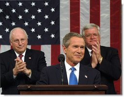 President George W. Bush reacts to applause while delivering the State of the Union address at the U.S. Capitol, Tuesday, Jan. 28, 2003. Also pictured are Vice President Dick Cheney, left, and Speaker of the House Dennis Hastert.  White House photo by Eric Draper
