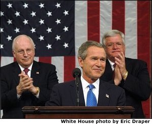 President George W. Bush reacts to applause while delivering the State of the Union address at the U.S. Capitol, Tuesday, Jan. 28, 2002. Also pictured are Vice President Dick Cheney, left, and Speaker of the House Dennis Hastert.