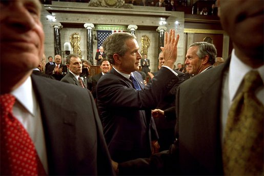 After delivering his State of the Union speech, President Bush waves to his wife, Laura Bush, as he leaves the House Chamber at the U.S. Capitol Tuesday, Jan. 28, 2003. White House photo by Eric Draper