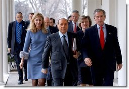 President George W. Bush and Italian Prime Minister Silvio Berlusconi walk along the colonnade after holding a joint press conference in the Oval Office Thursday, Jan. 30, 2003.  White House photo by Tina Hager