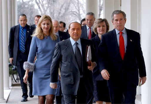 President George W. Bush and Italian Prime Minister Silvio Berlusconi walk along the colonnade after holding a joint press conference in the Oval Office Thursday, Jan. 30, 2003. White House photo by Tina Hager.