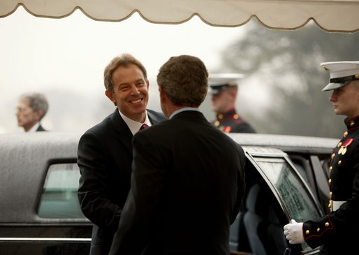 President George W. Bush welcomes British Prime Minister Tony Blair upon his arrival to the White House Friday, Jan. 31, 2003. White House photo by Paul Morse