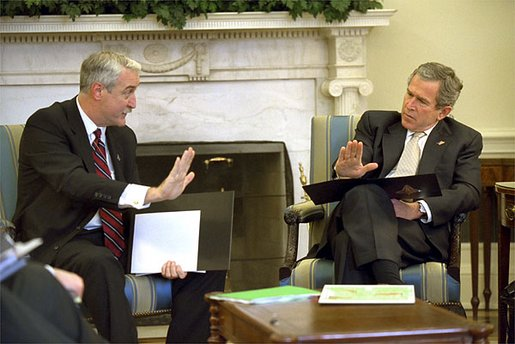 Reviewing a report about the Space Shuttle Columbia tragedy, President George W. Bush meets with NASA Administrator Sean O'Keefe in the Oval Office Monday, Feb. 3, 2003. White House photo by Eric Draper